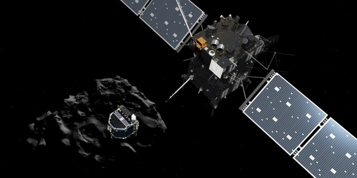 """TOPSHOTS A handout released by the ESA/ATG medialab on November 12, 2014 shows an artists impression of the European probe Philae separating from its mother ship Rosetta and descending to the surface of comet 67P/Churyumov-Gerasimenko. The European probe Philae on November 12 was on course to make the first-ever landing on a comet after separating from its mother ship Rosetta, mission control said. AFP PHOTO / ESA/ATG MEDIALAB   -- RESTRICTED TO EDITORIAL USE - MANDATORY CREDIT """" AFP PHOTO / ESA/ATG MEDIALAB """" - NO MARKETING NO ADVERTISING CAMPAIGNS - DISTRIBUTED AS A SERVICE TO CLIENTS --"""